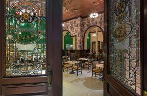 A restaurant or other place to eat at The Driskill, in The Unbound Collection by Hyatt