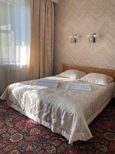 Кровать или кровати в номере Гостиница Гостевой дом