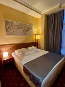 Кровать или кровати в номере Бутик-отель «Чкалов»