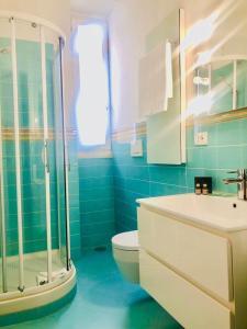 A bathroom at Via Del Corso Home Roma