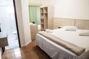 A bed or beds in a room at Avenida Palace Hotel