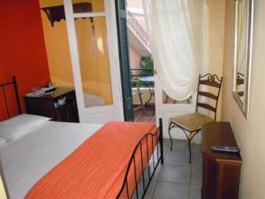 A bed or beds in a room at Atheaton Traditional Guesthouse