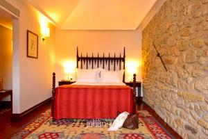 A bed or beds in a room at Casa Melo Alvim - member of Unlock Boutique Hotels