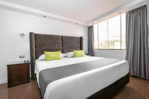 A bed or beds in a room at Ayenda Casa Aika