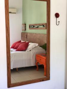 A bed or beds in a room at Pousada Tatuapara
