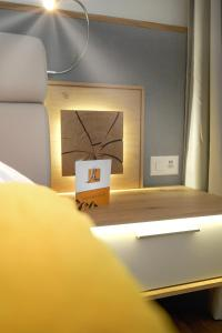Ein Bett oder Betten in einem Zimmer der Unterkunft Hotel Alpina