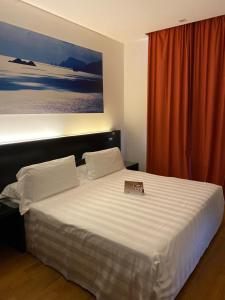 A bed or beds in a room at Card International Hotel