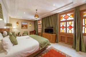 Cama o camas de una habitación en La Maison Arabe Hotel, Spa & Cooking Workshops