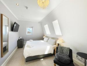 A bed or beds in a room at Dukes Folly Hotel
