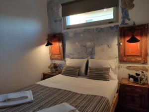A bed or beds in a room at Be My Neighbour