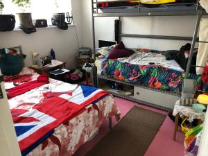 A bed or beds in a room at Wellness Haven Micro Pop-up Hostel Catford