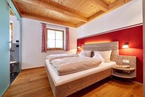 A bed or beds in a room at Ferienhaus Alpinissimo