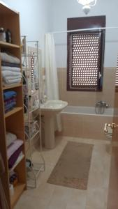 A bathroom at Appartment in Sizilien Ribera