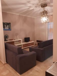 A seating area at Appartment in Sizilien Ribera