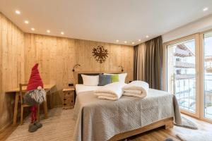 A bed or beds in a room at ALPtyrol