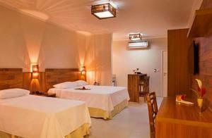 Cama ou camas em um quarto em Resort da Ilha
