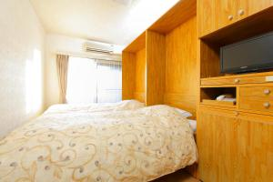 A bed or beds in a room at FLEXSTAY INN Nakanobu