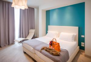 A bed or beds in a room at Forte16 View & SPA