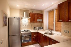 Кухня или мини-кухня в Студио Апартаменты на Волгоградском проспекте