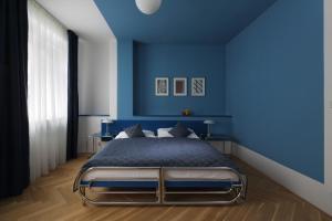 Кровать или кровати в номере AXA Hotel