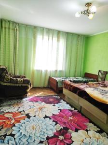 Cama o camas de una habitación en Guest House Dinara