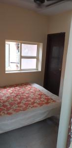A bed or beds in a room at Ever Green Guest House