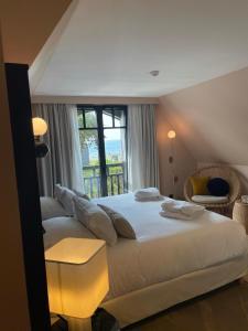 Un ou plusieurs lits dans un hébergement de l'établissement Le Celtique & Spa