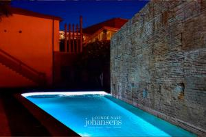 The swimming pool at or near Casa Melo Alvim - member of Unlock Boutique Hotels