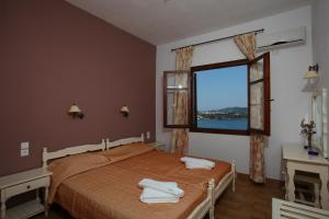 En eller flere senger på et rom på Villa Melia