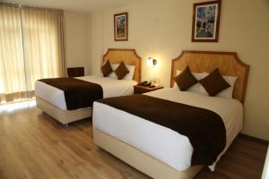 A bed or beds in a room at Sol Plaza Hotel