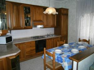 Kuchyň nebo kuchyňský kout v ubytování La Bosega