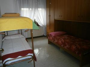 Palanda nebo palandy na pokoji v ubytování La Bosega