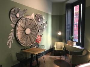 A seating area at Joya del Casco Boutique Hotel by Shiadu