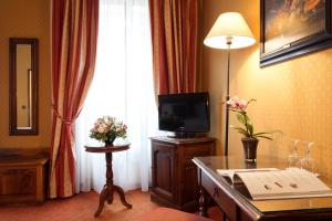 A television and/or entertainment center at Amarante Beau Manoir