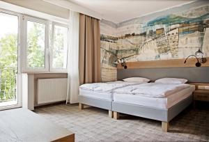 Łóżko lub łóżka w pokoju w obiekcie Dom Wczasowy Beskidy