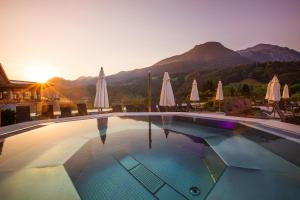 The swimming pool at or near Hotel EDELWEISS Berchtesgaden Superior