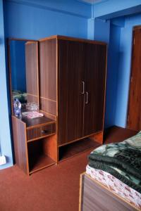 A bed or beds in a room at Riva Homestay