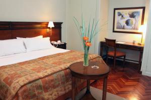 Кровать или кровати в номере Hotel Colonial San Nicolás
