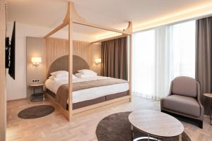 A bed or beds in a room at Nordic Hotel Forum