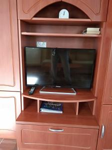 A television and/or entertainment centre at YELLOW APARTMAN