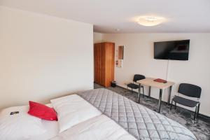 A bed or beds in a room at Parc Fermé