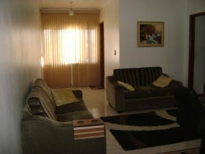 A seating area at Apartamento Guarulhos