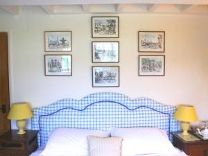 A bed or beds in a room at Stone House