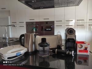 A cozinha ou kitchenette de AL-Formoso