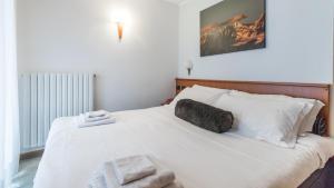 Ein Bett oder Betten in einem Zimmer der Unterkunft Hotel Pizzo Scalino