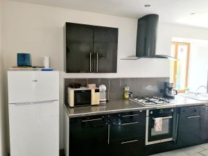 A kitchen or kitchenette at Gite de Circourt