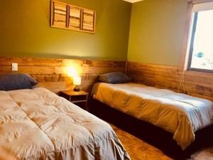 A bed or beds in a room at Huella Patagónica Hostel