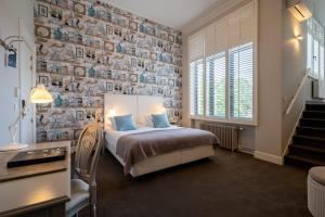 Un ou plusieurs lits dans un hébergement de l'établissement Hotel Made In Louise