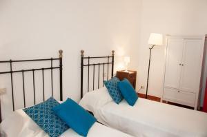 Letto o letti in una camera di Borgo Castagnoli