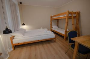 A bunk bed or bunk beds in a room at Olle